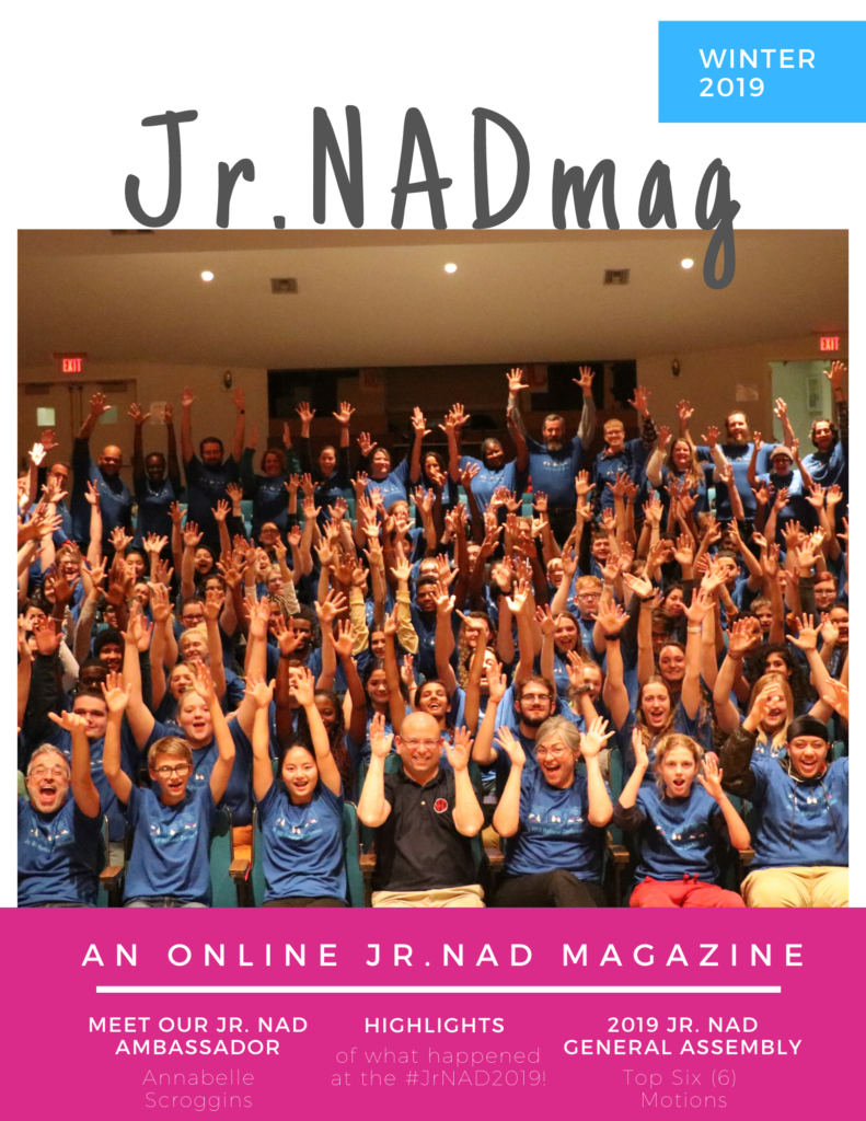 """Text on top, centered: """"Jr. NADmag"""" There is a blue banner on right with text: """"Winter 2019"""". A photo is centered, taking on the entire graphic, of Jr. NAD Conference attendees waving their hands. Pink banner on the bottom with text: """"An Online Jr. NAD Magazine, Meet our Jr. NAD Ambasador Annabelle Scroggins, Highlights of what happened at the #JrNAD2019, 2019Jr. NAD General Assembly, Top Six (6) Motions"""""""