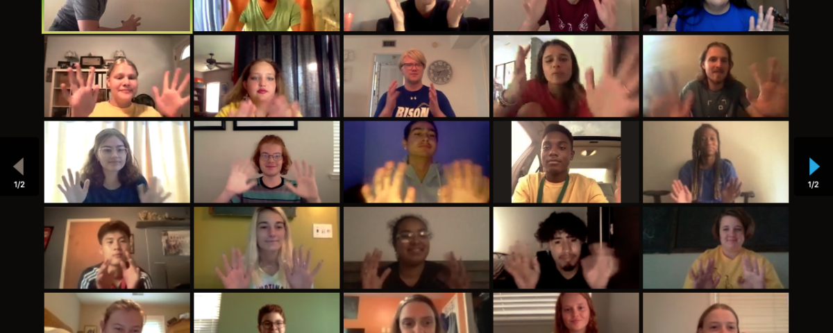 Zoom screenshot of campers and staff waving their hands.
